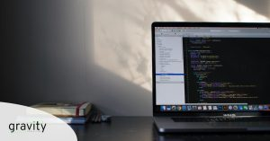 Why Use Wordpress for Web Design. Computer on desk displaying code.